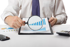 Businessman counting losses and profit working with statistics, analyzing financial the results on white background Stock Images