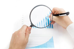 Businessman counting losses and profit working with statistics, analyzing financial the results on white background Stock Image