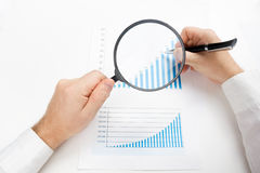 Businessman counting losses and profit working with statistics, analyzing financial the results on white background Royalty Free Stock Images