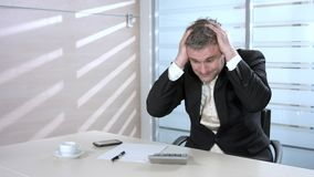 Businessman counting losses. stock footage