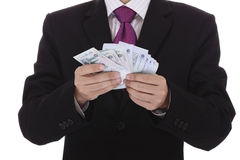 Businessman counting money Stock Images