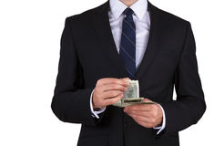 Businessman is counting money Stock Photography