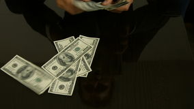 Businessman counting money on the table stock video