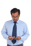 Businessman counting money Stock Photography