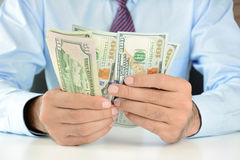 Businessman counting money,US dollar (USD) banknotes Stock Photography
