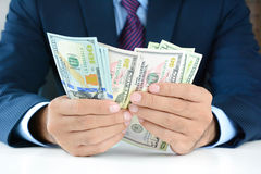 Businessman counting money,US dollar (USD) bills Royalty Free Stock Photos