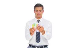Businessman counting money Royalty Free Stock Photo