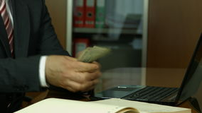 Businessman counting money and writing info stock video