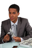 Businessman counting money Stock Photo