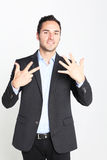 Businessman counting number eight Stock Photography