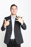 Businessman counting number seven Stock Images