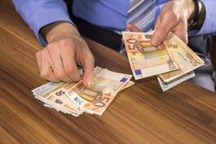 Businessman counts euro money Royalty Free Stock Image