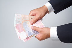 Businessman counts money Royalty Free Stock Photo