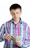 Businessman counts money in hands. Royalty Free Stock Photo