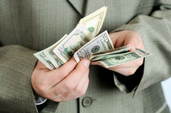 Businessman counts money in hands. Royalty Free Stock Photography