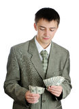 Businessman counts money in hands. Stock Images