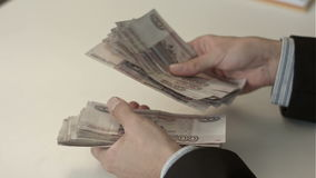 Businessman counts money in hands stock footage