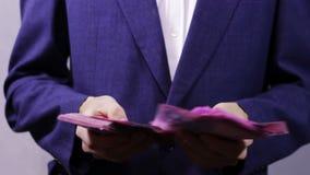 Businessman Counts Money in Hands. stock video footage