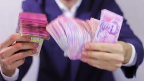 Businessman Counts Money in Hands. stock footage