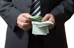 Businessman counts money Stock Photo