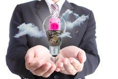 Businessman cover earning money bulb piggy bank Royalty Free Stock Photos