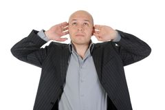 Businessman covered his ears Stock Photo