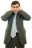 Businessman covered his ears with his hands Stock Photo