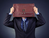 Businessman covered his head portfolio Royalty Free Stock Photos