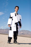 Businessman covered with papers stock photography