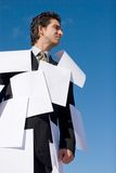 Businessman covered with papers Stock Image
