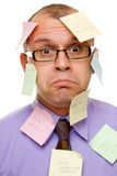 Businessman covered with sticky notes Stock Image