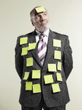 Businessman Covered With Sticky Notes Stock Images