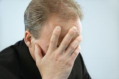 Businessman covering face Royalty Free Stock Image