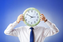 Businessman covering  face with clock Royalty Free Stock Image