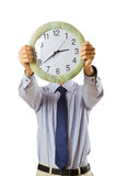 Businessman covering  face with clock Stock Photo
