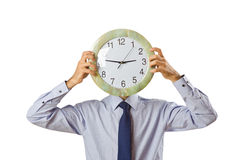 Businessman covering  face with clock Stock Photos