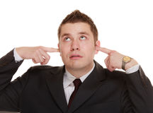 Businessman covering his ears, funny expressions Royalty Free Stock Images