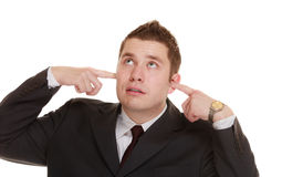 Businessman covering his ears, funny expressions Stock Photos