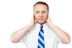 Businessman covering his ears with his hands Royalty Free Stock Photography