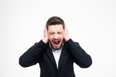 Businessman covering his ears and screaming Royalty Free Stock Image