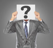 Businessman with question mask Royalty Free Stock Photos