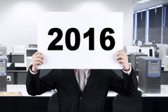 Businessman covering his face with number 2016 Stock Image