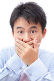 Businessman covering his mouth with hand Stock Images