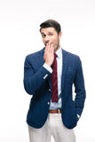 Businessman covering his mouth Stock Images