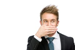 Businessman covering mouth with hand Royalty Free Stock Images