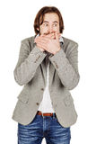 Businessman covering mouth with hands. emotions and people conce Stock Photo