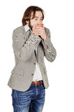 Businessman covering mouth with hands. emotions and people conce Royalty Free Stock Images