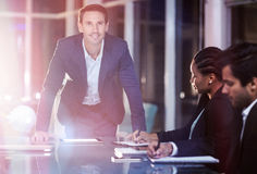 Businessman with coworkers in meeting. 3D Businessman with coworkers in meeting at conference room Stock Photo