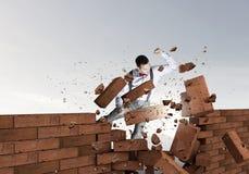 Businessman crashing bricks Royalty Free Stock Photos