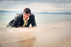 Businessman Crawling To Safety Stock Image
